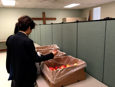 Northern State University students picking out fruit during the Salvation Army's Student Day. Photo credit: Joseph Park.
